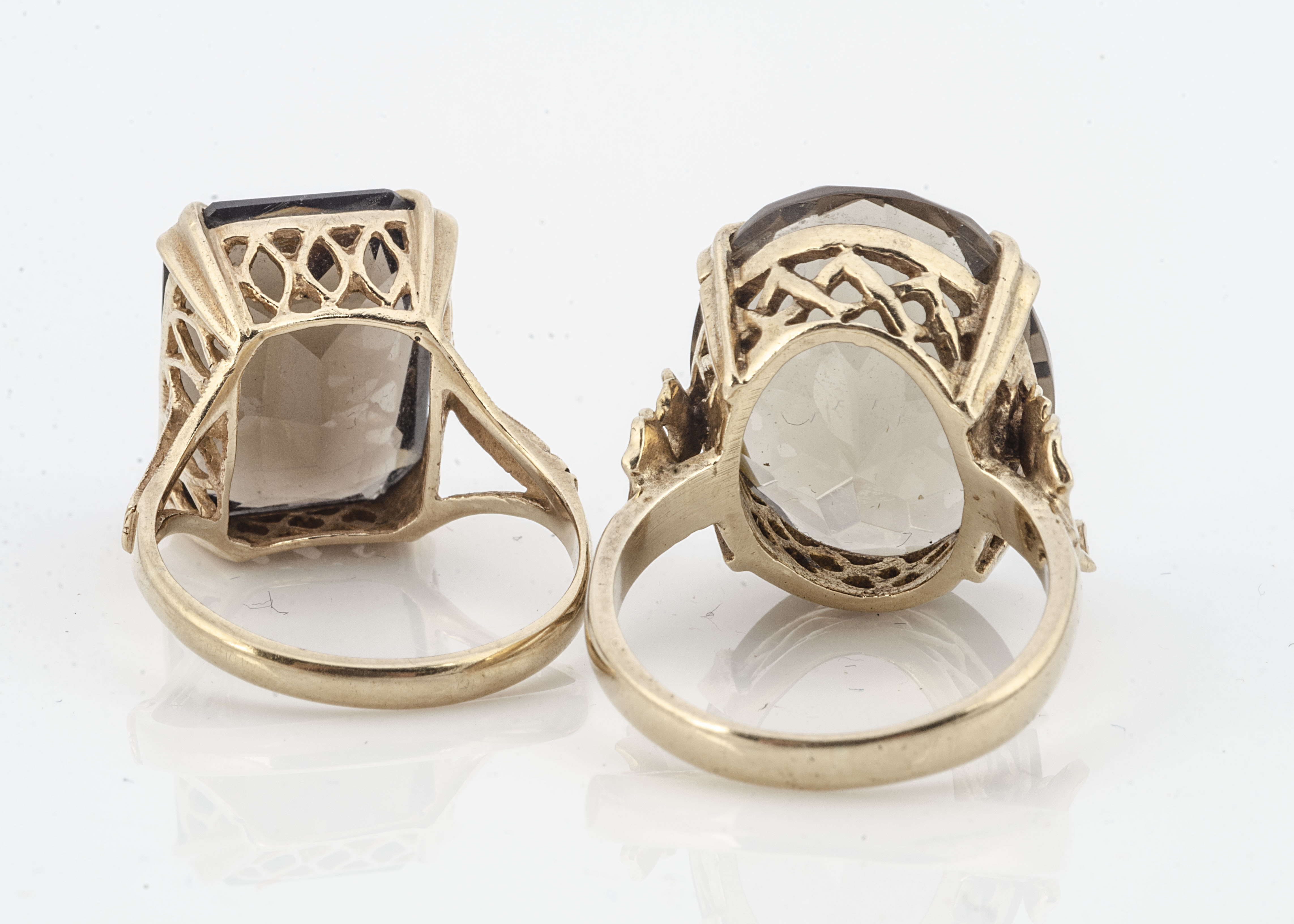 A smokey quartz 9ct gold cocktail ring, oval mixed cut in four claw setting, ring size M together - Image 2 of 2