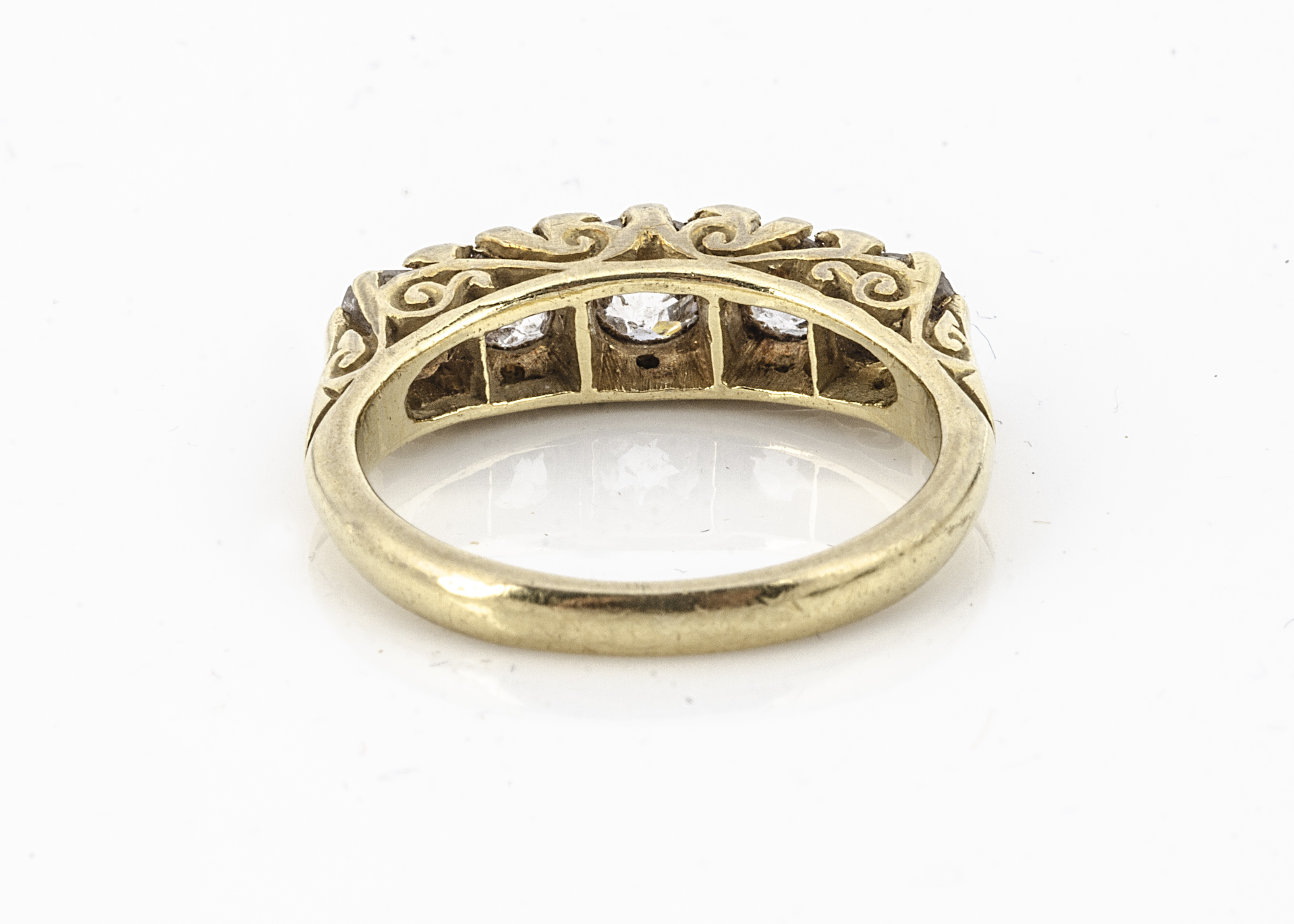 An 18ct gold five stone diamond ring, the old cut diamonds in claw settings with scroll gallery, - Image 2 of 2
