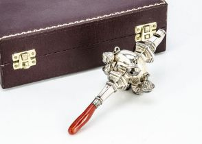 A c1960s silver and coral baby's rattle, in fitted Asprey & Co box, 13cm long, 2.1 ozt, marks worn