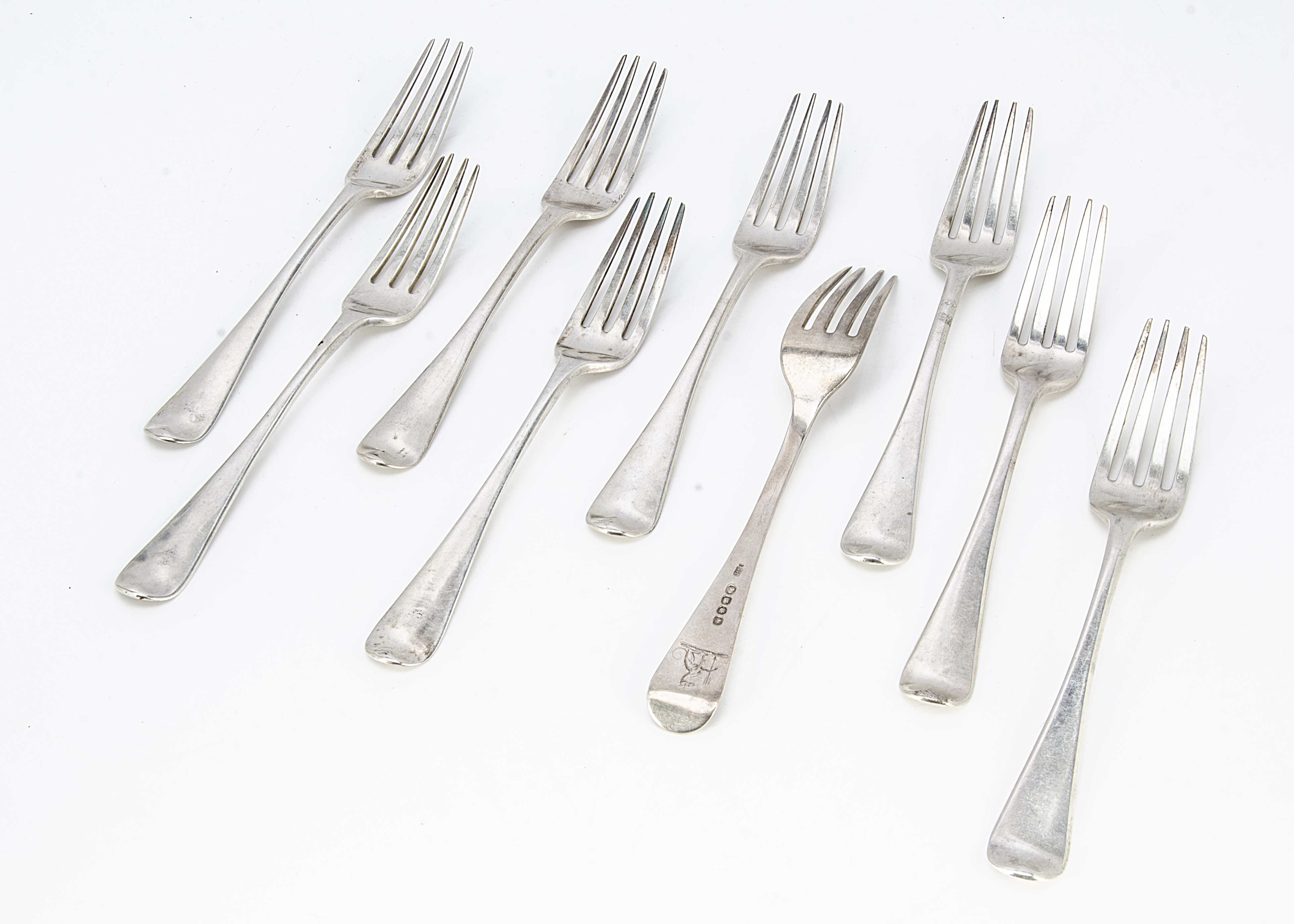 A set of nine George III silver dinner forks by Solomon Hougham, Old English pattern, with family