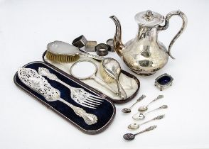 A collection of silver and silver plate, including four napkin rings, tea and coffee spoons, a