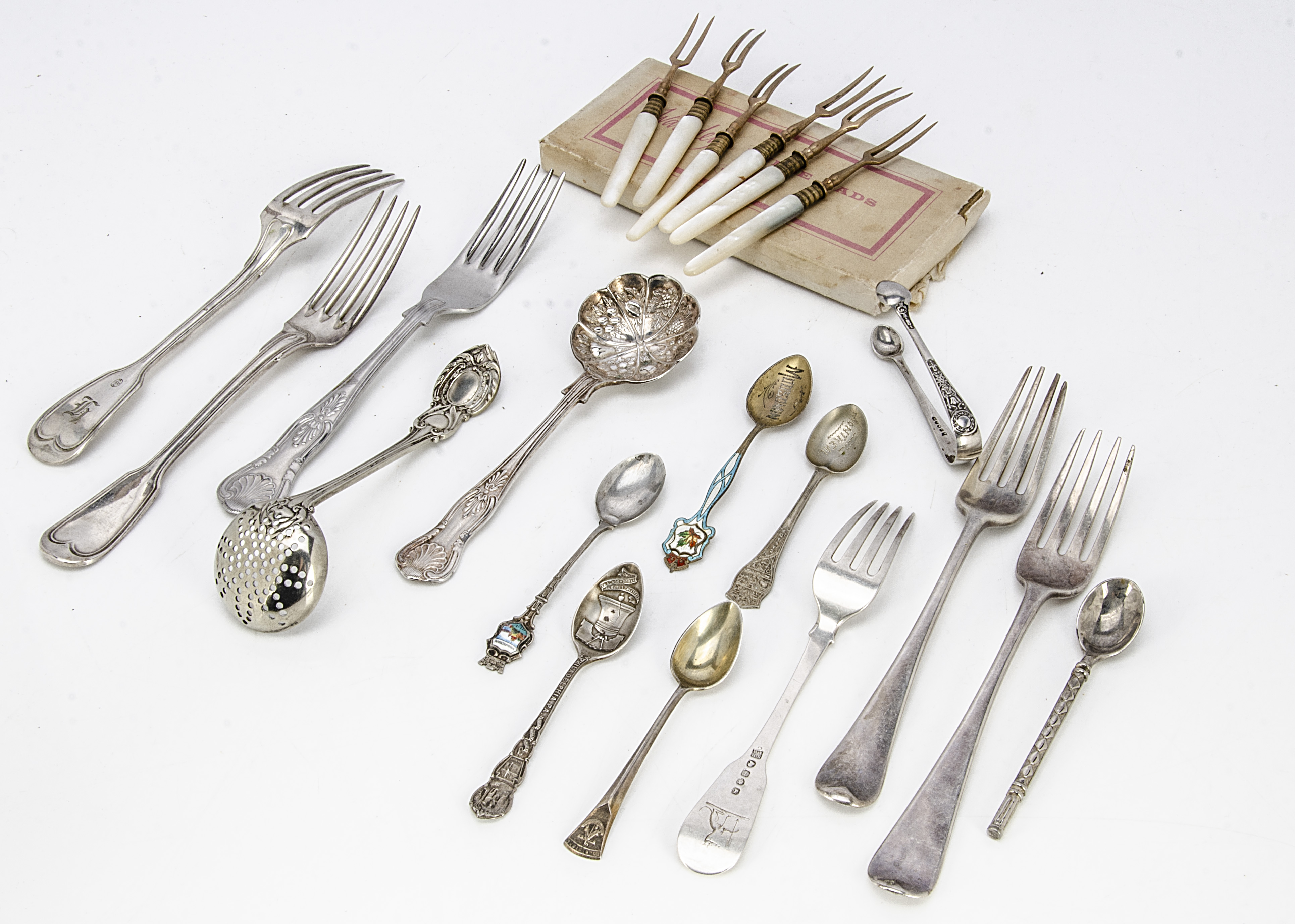 A collection of silver and silver plated flatware, including a pair of George III silver old English