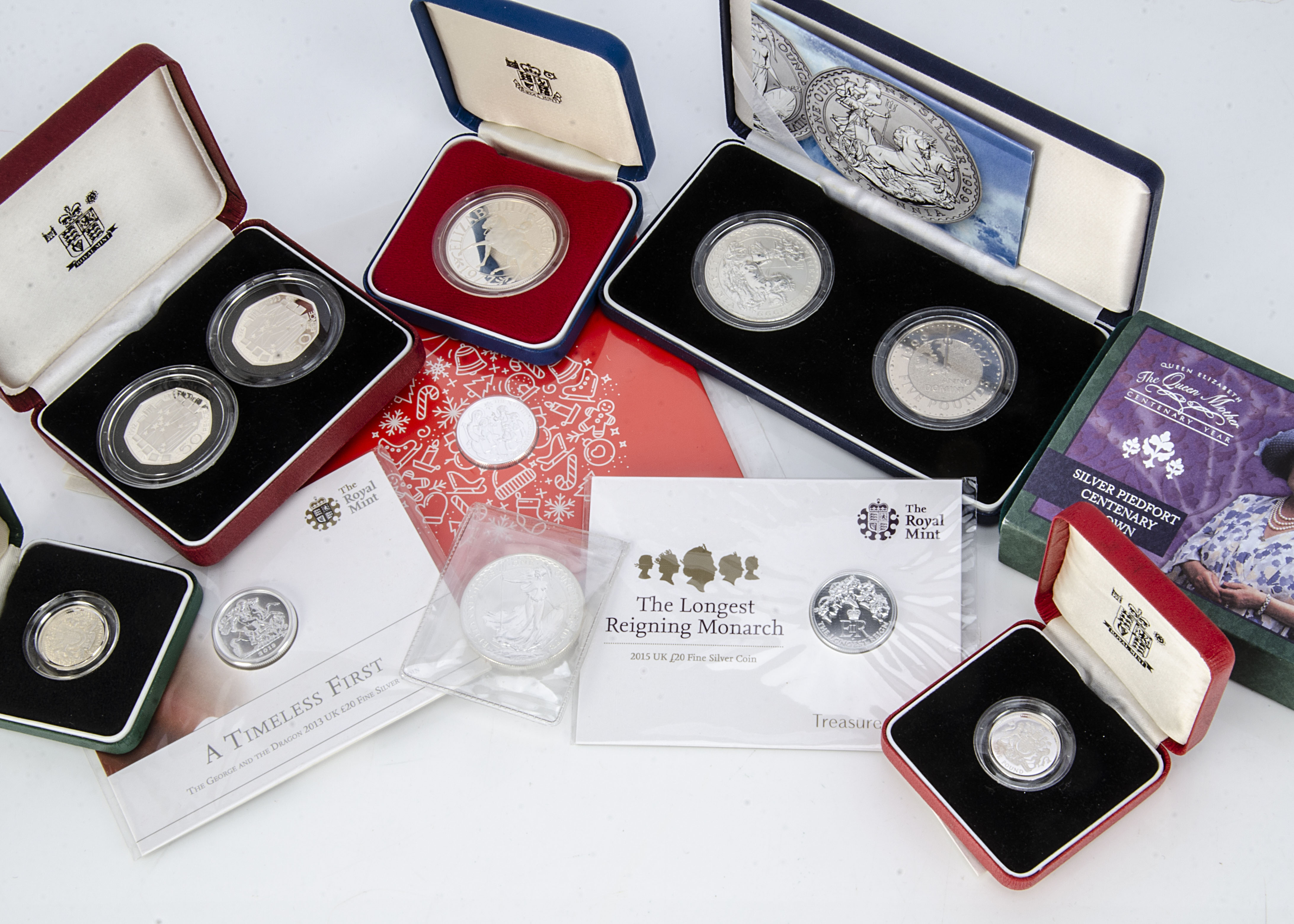 Eleven modern Royal Mint silver proof and silver coins, including a 1977 crown in box, a Queen
