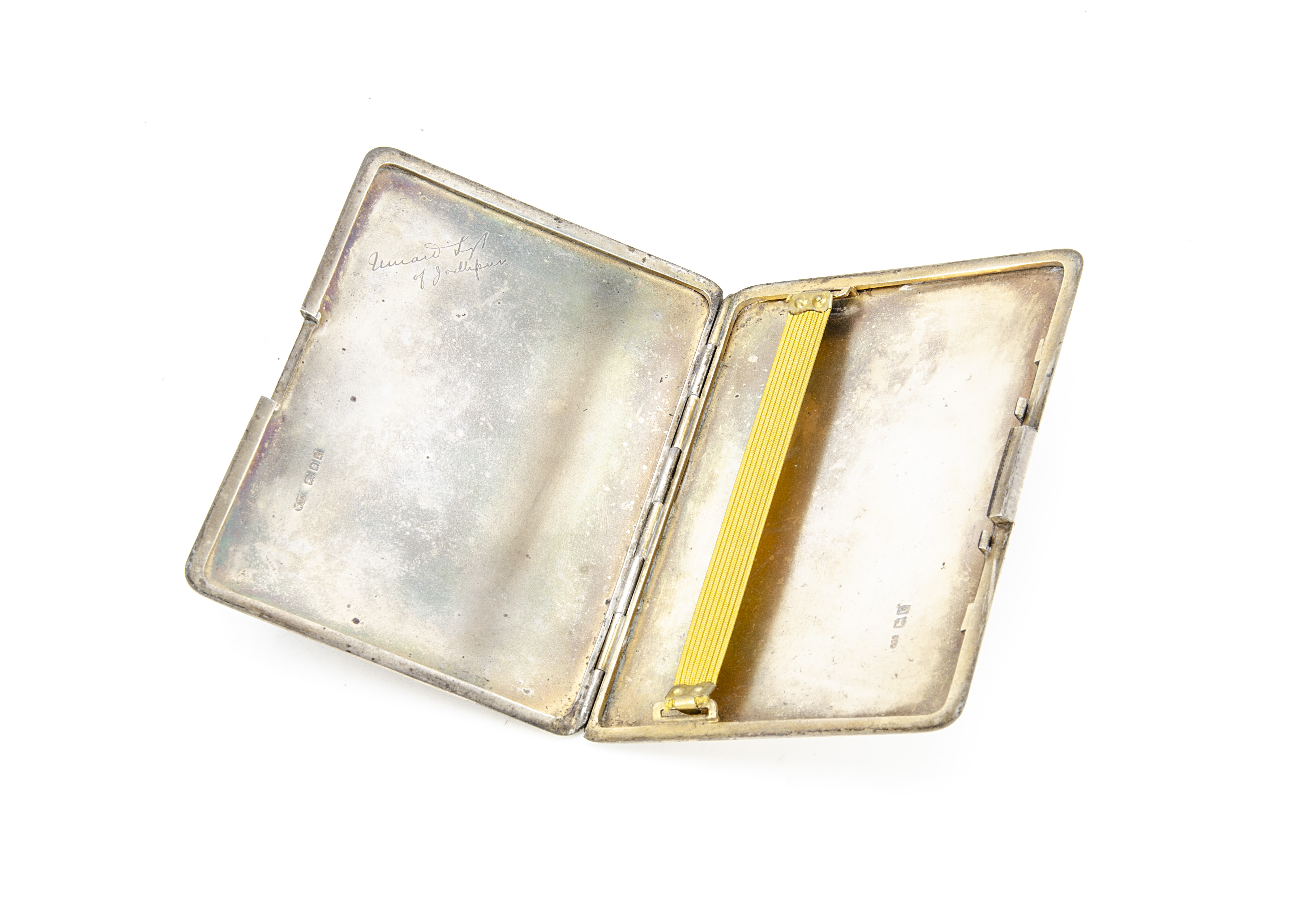 An Art Deco silver cigarette case by WFW, engine turned having blue enamel monogram and coronet, 5.7 - Image 2 of 3