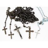A collection of rosaries, ebony, brass and base metal 140cm long and others