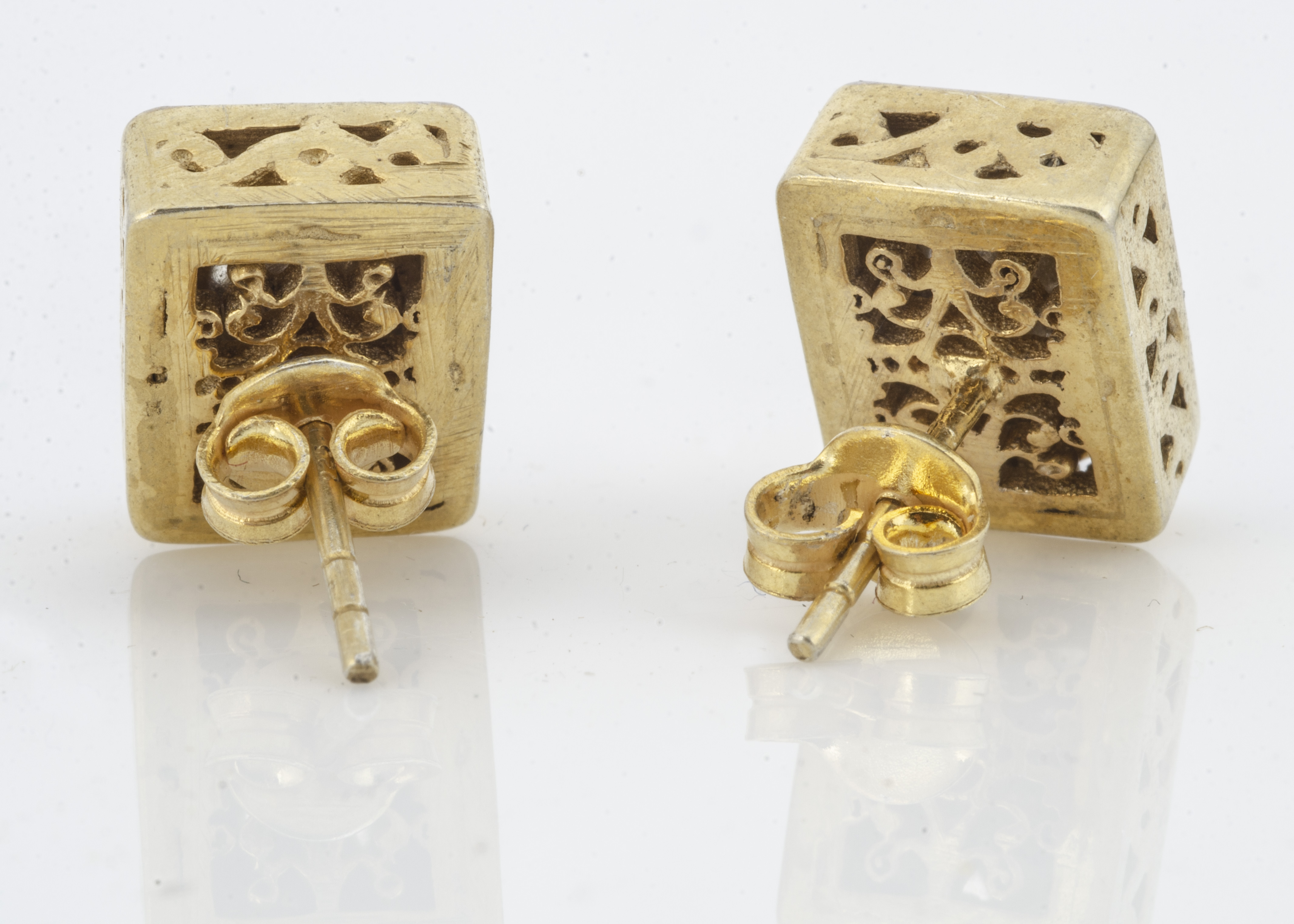 A pair of silver gilt and diamond slither stud earrings, in rubbed over settings of rectangular - Image 2 of 2