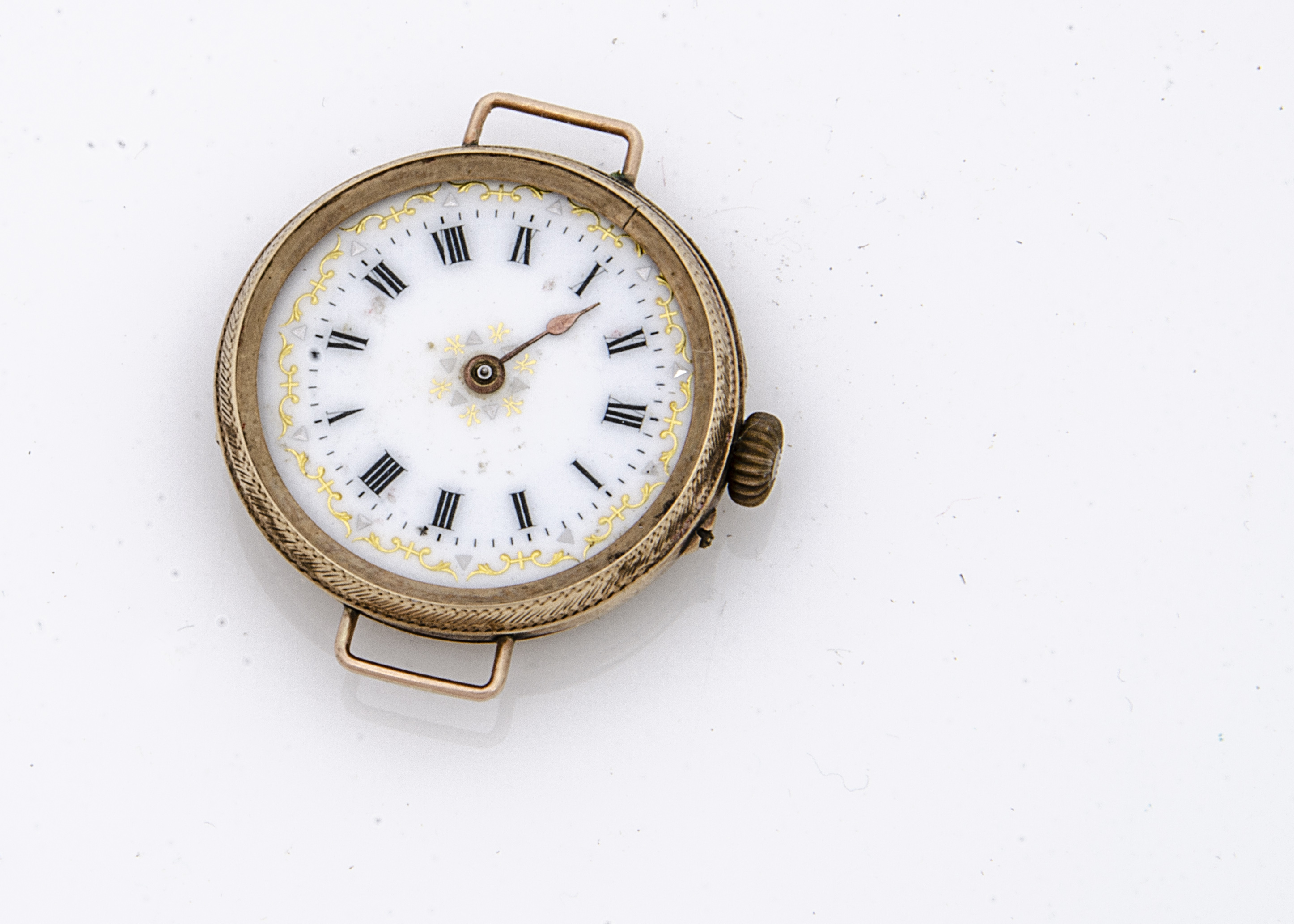 A late 19th Century 9ct gold cased pocket watch converted to wristwatch, 30mm, white enamel dial,