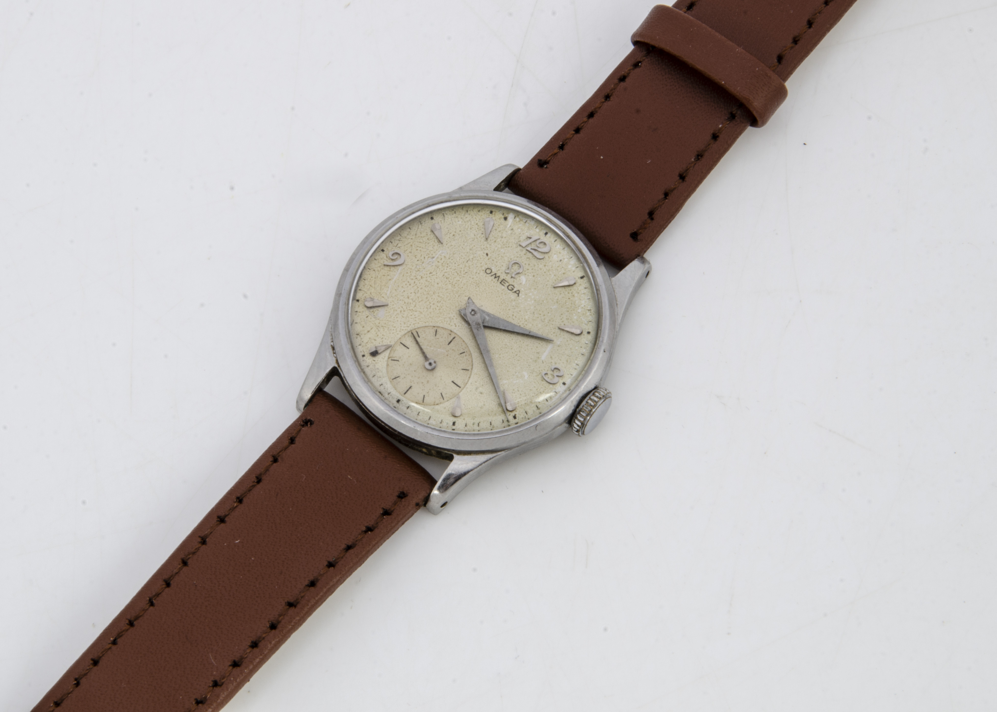 A 1950s Omega stainless steel gentleman's wristwatch, 34mm, cream coloured dial with batons,