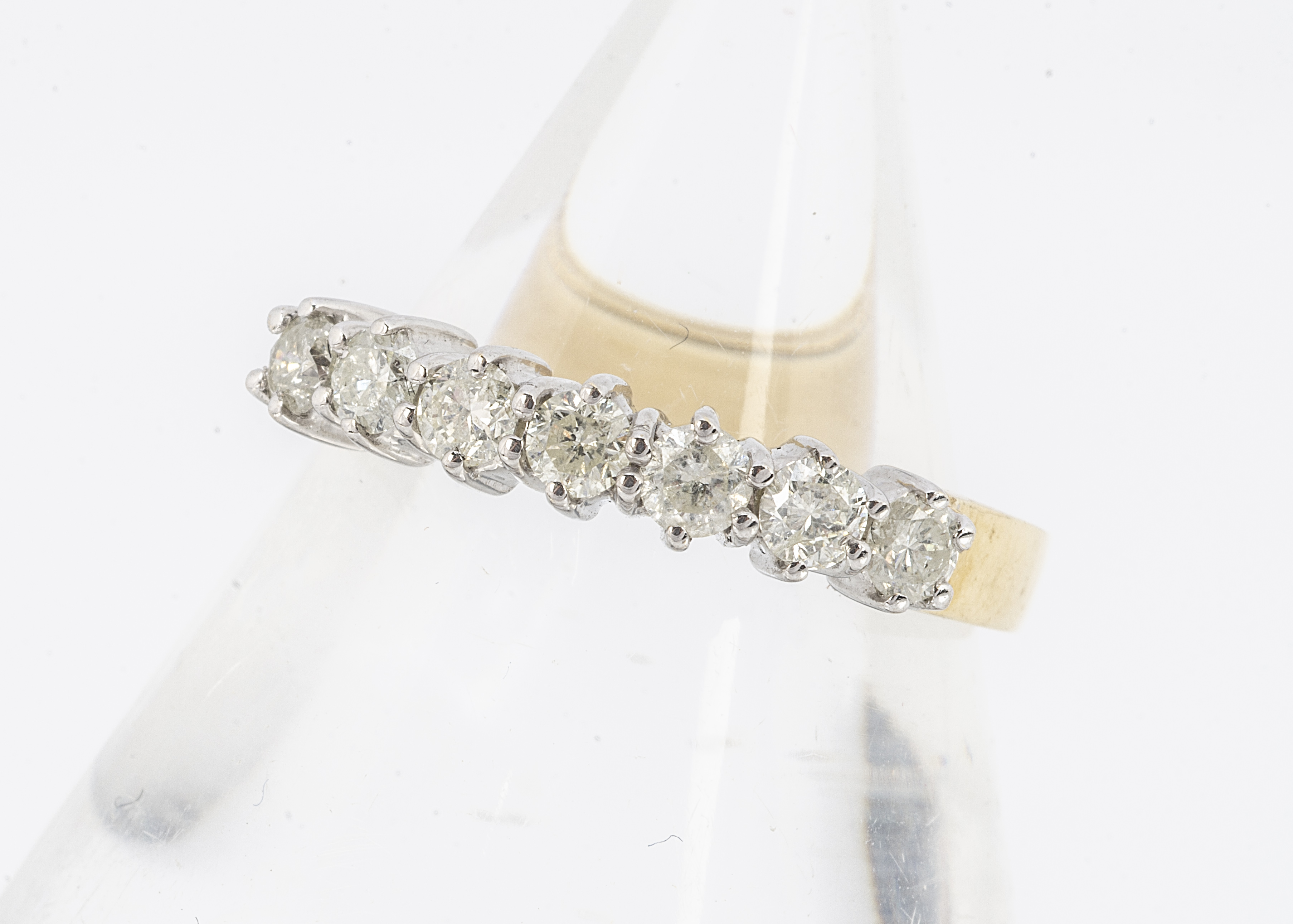 A certificated diamond seven stone dress ring, the seven brilliant cuts in claw setting, 18ct gold
