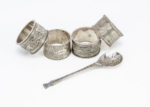 Two pairs of napkin rings and a spoon, one pair of 1940s examples with Lawrie & Joan engraved, the