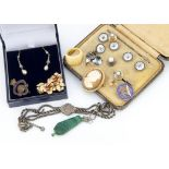 A collection of miscellaneous jewellery, including a silver watch chain, a shell cameo, a silver
