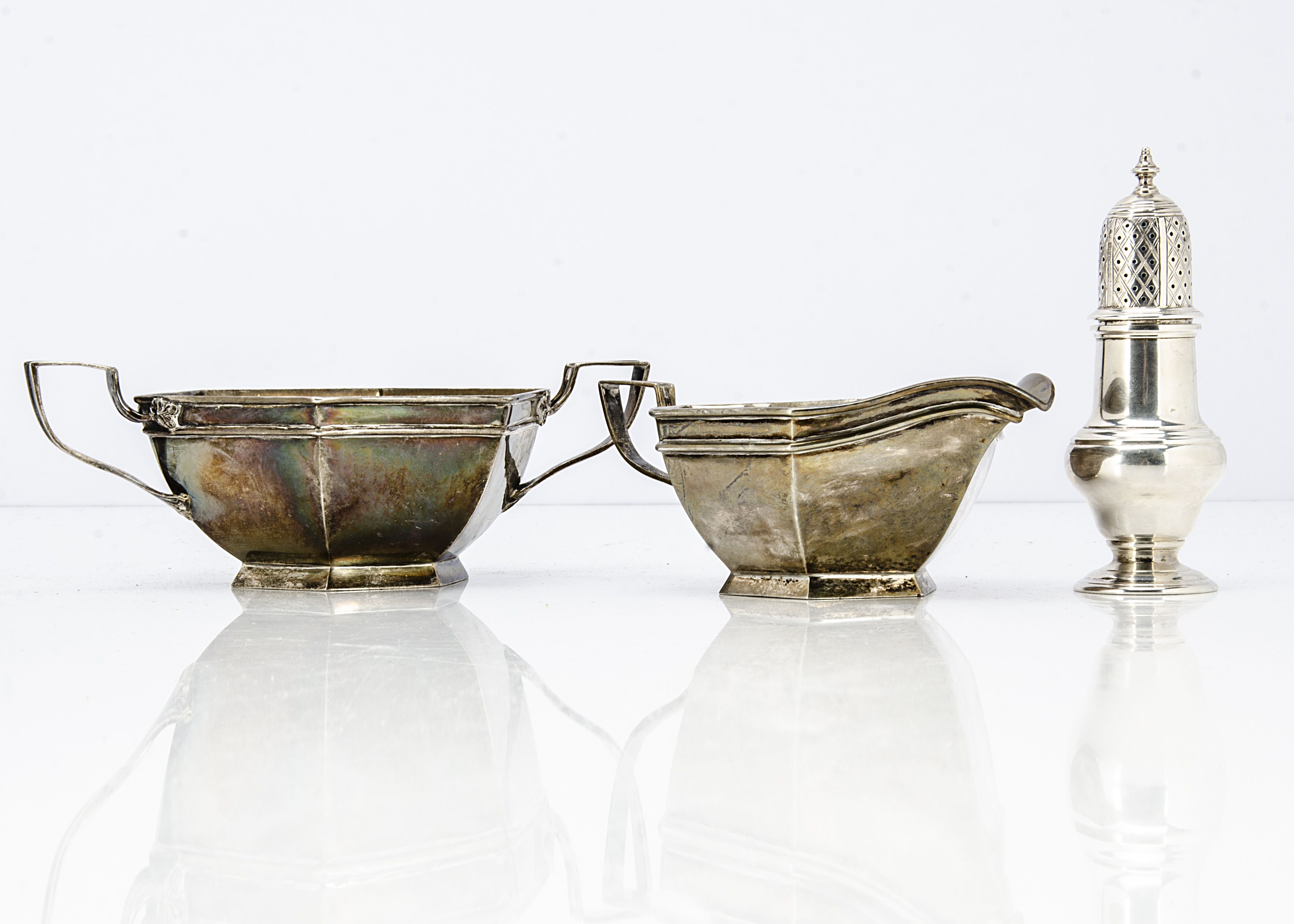 An Art Deco period silver milk jug and sugar basin by Walker & Hall, hexagonal with applied handles,