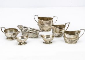 Seven Victorian and later items of silver, including a pierced dish, sugar basin, three milk and