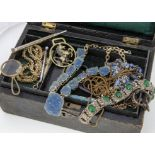 A collection of costume jewellery, including a blue paste necklace gilt necklace, leather