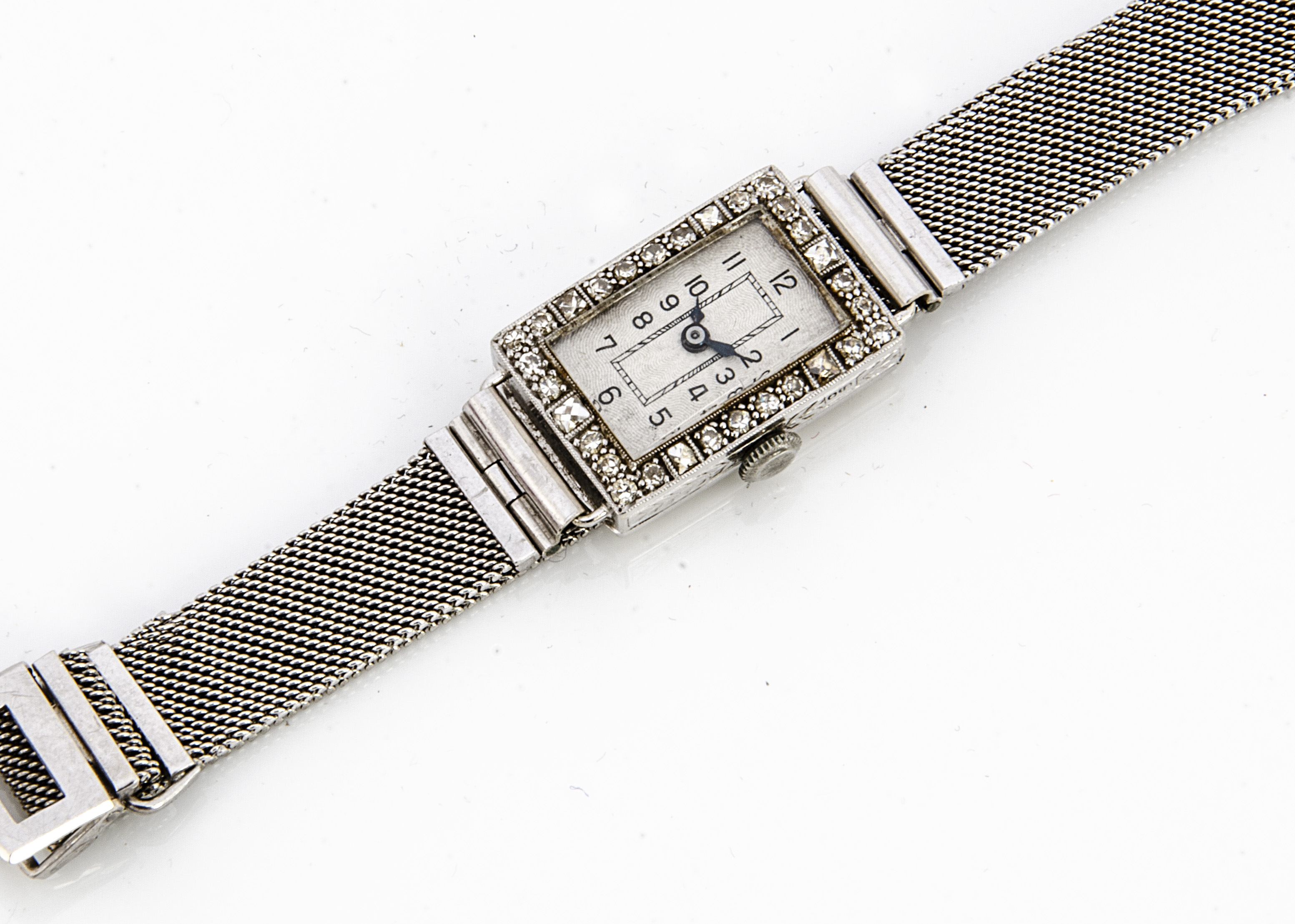 An Art Deco 18ct gold and diamond dress watch, of rectangular form with guilloche enamel face,