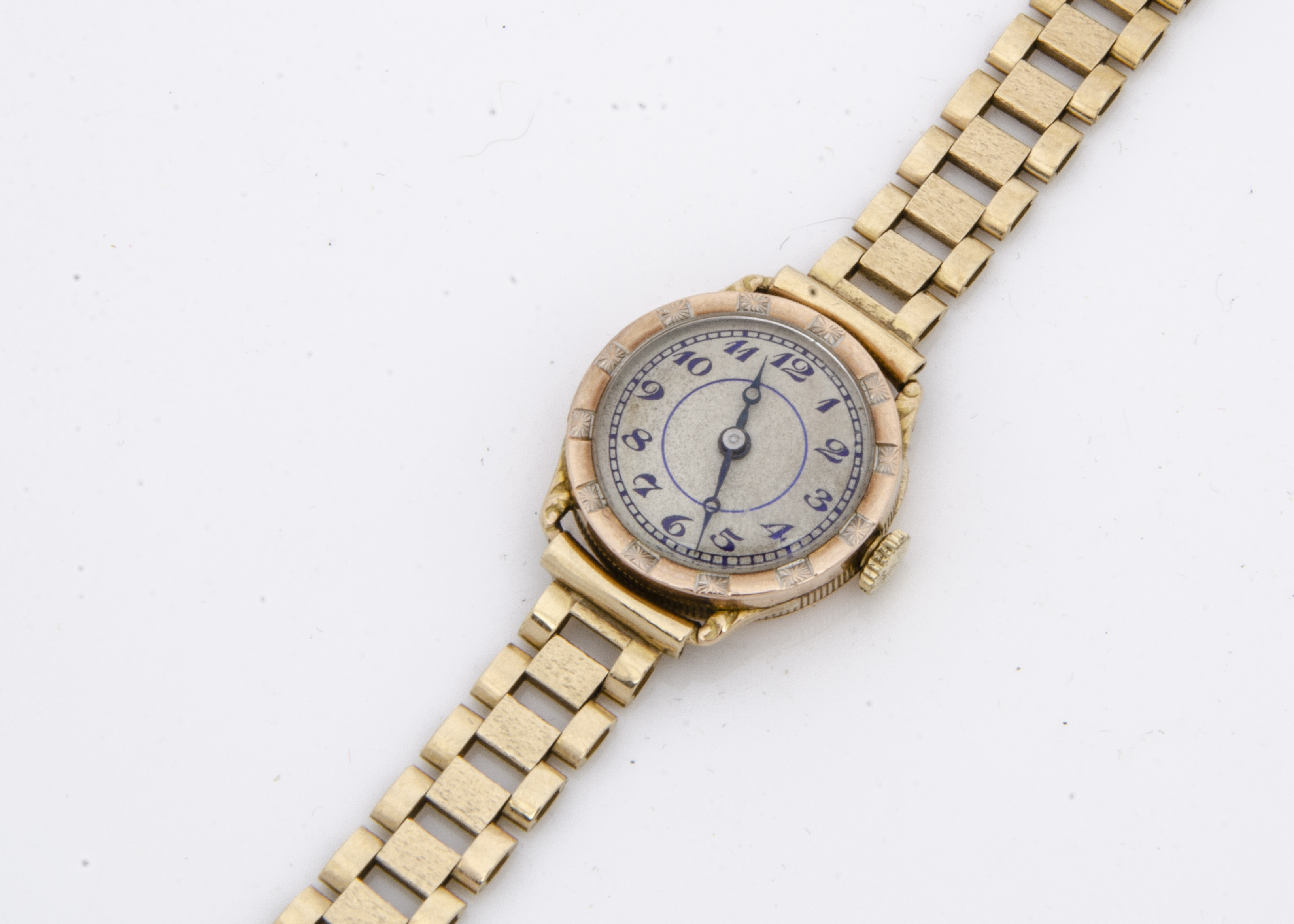 An Art Deco period 9ct gold cased lady's wristwatch, circular 22mm case, hinged snapped, appears