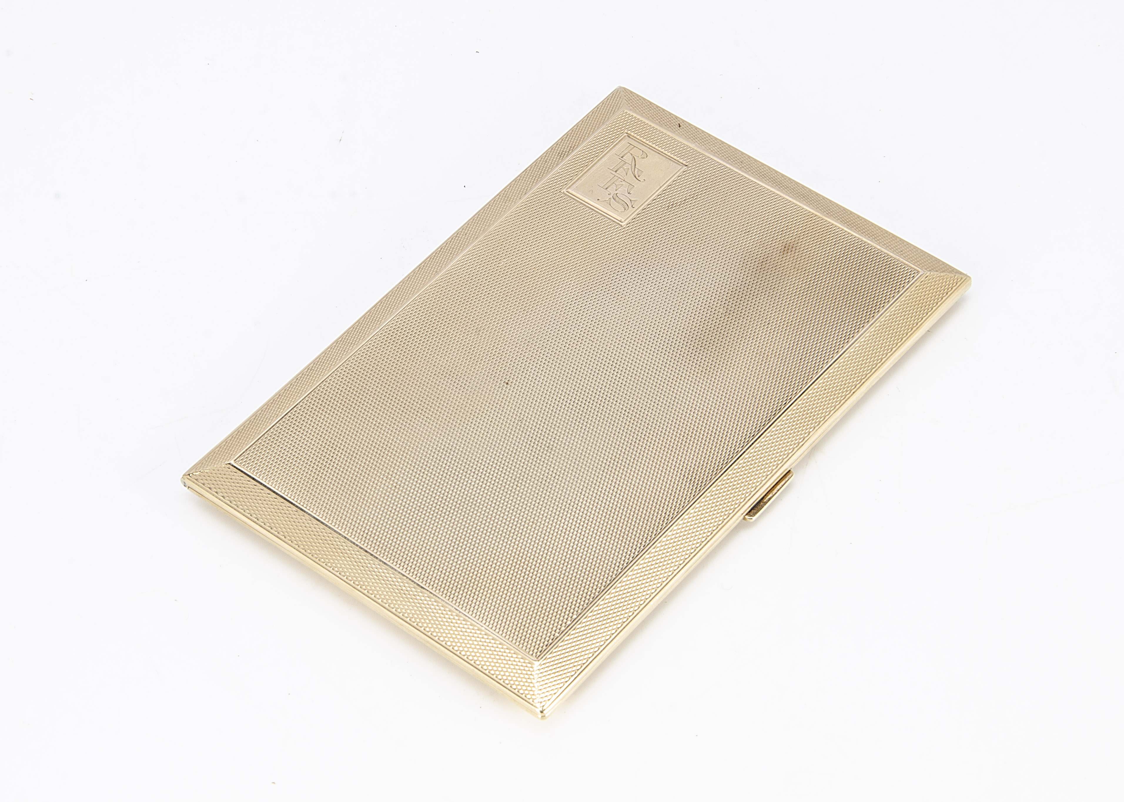 A George V 9ct gold cigarette case by C & C, rectangular with engine turned exterior, initials