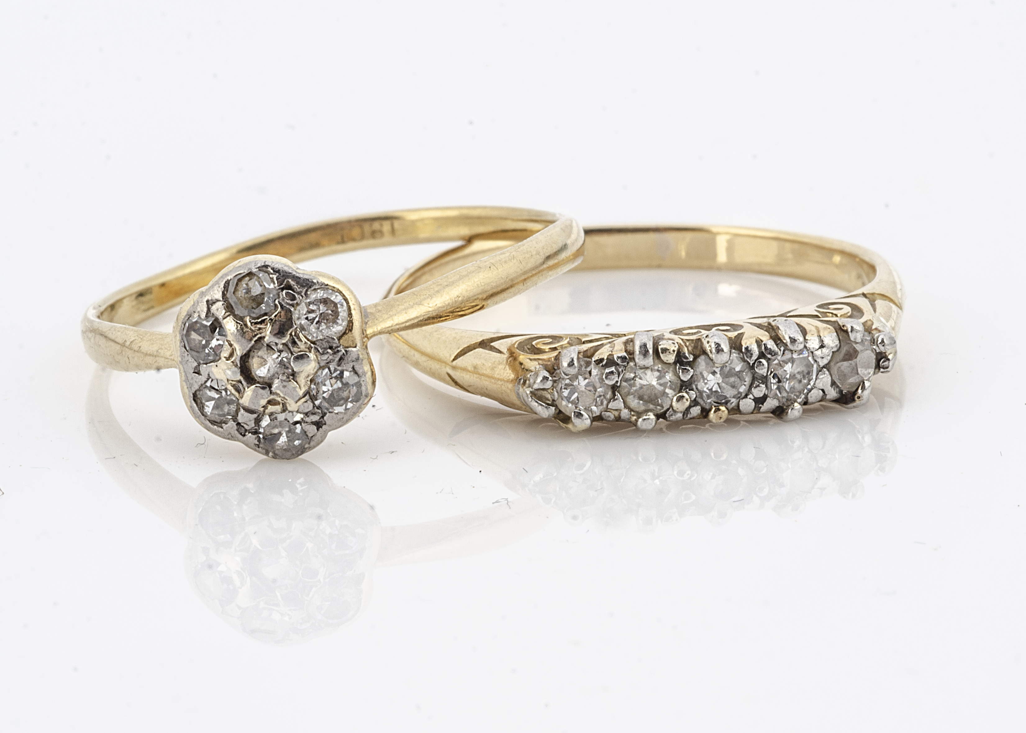 A five stone diamond dress ring, claw set eight cut diamonds in white metal on yellow gold shank