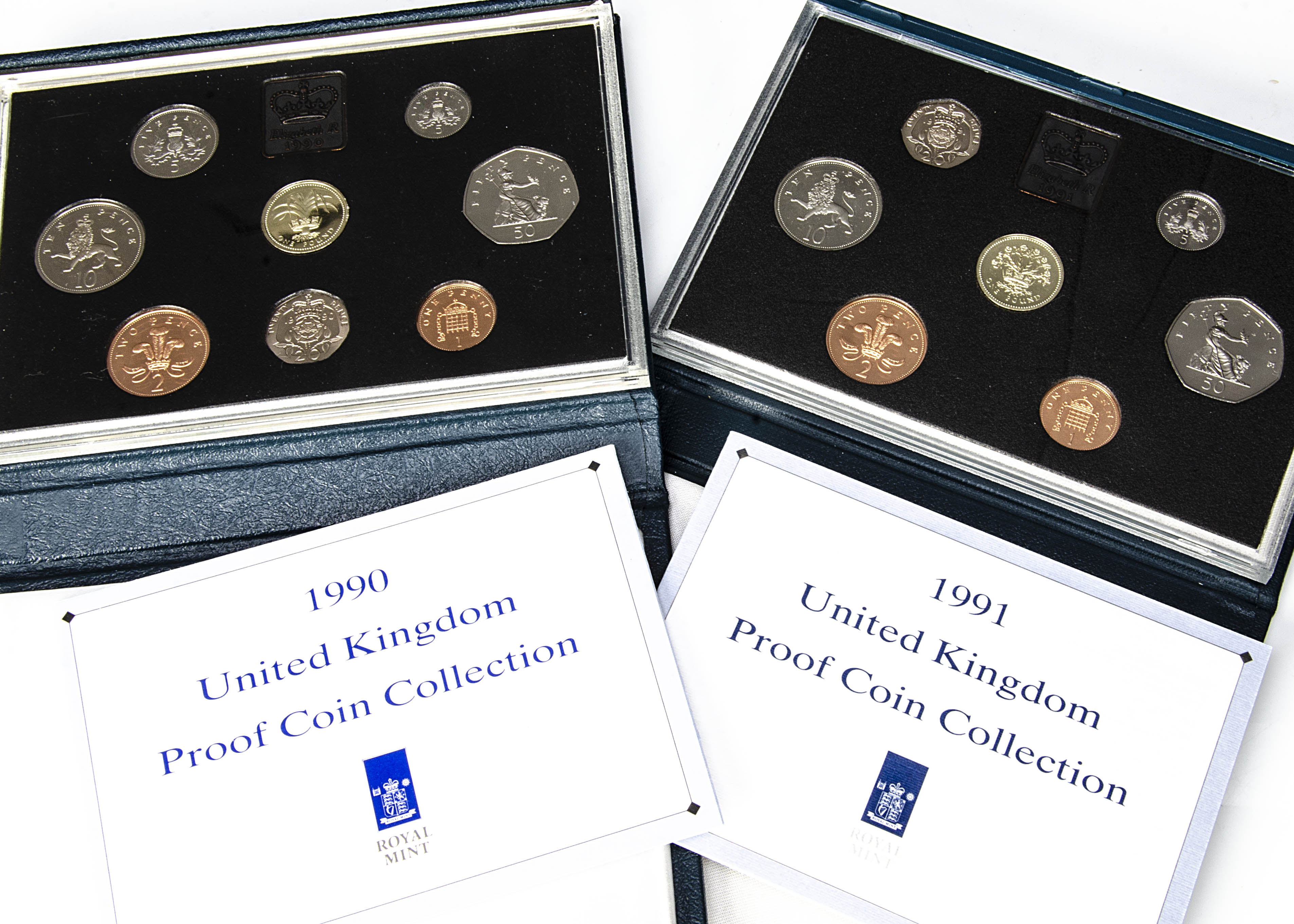 A set of ten Royal Mint UK proof coin sets, a run from 1990 to 1999, appear unopened, with year