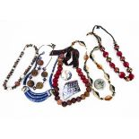 Various Middle Eastern and North African jewels and beads, together with a collection of ceramic and