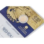 A modern Royal Mint UK 22ct Gold Bullion Half Sovereign coin, dated 2005, in card pack and