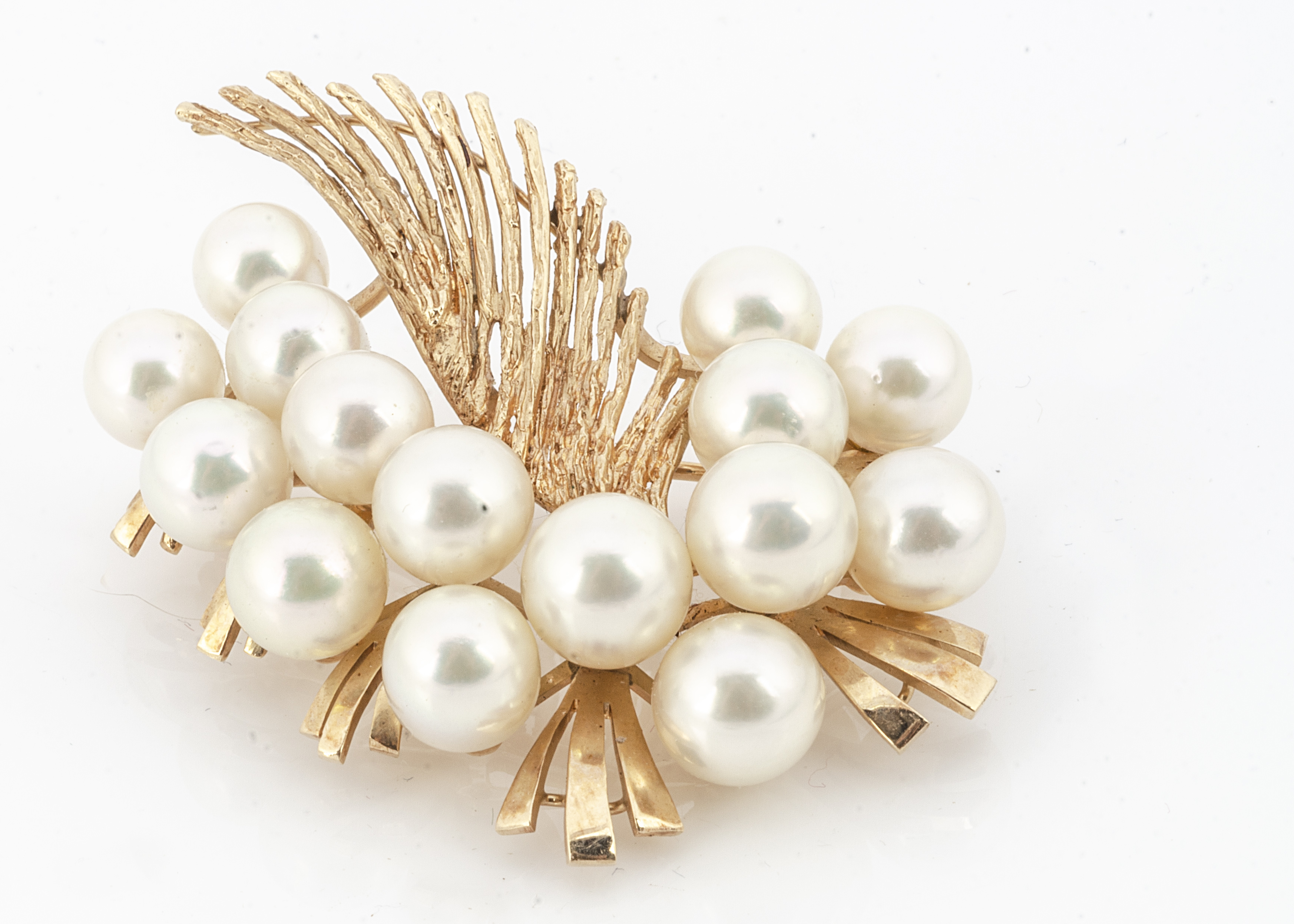 A continental yellow metal and cultured pearl brooch, of feather and pearl cluster design marked 14k
