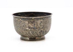 A Victorian silver sugar basin by Edward Hutton, circular footed bowl with raised design, 4.1 ozt,