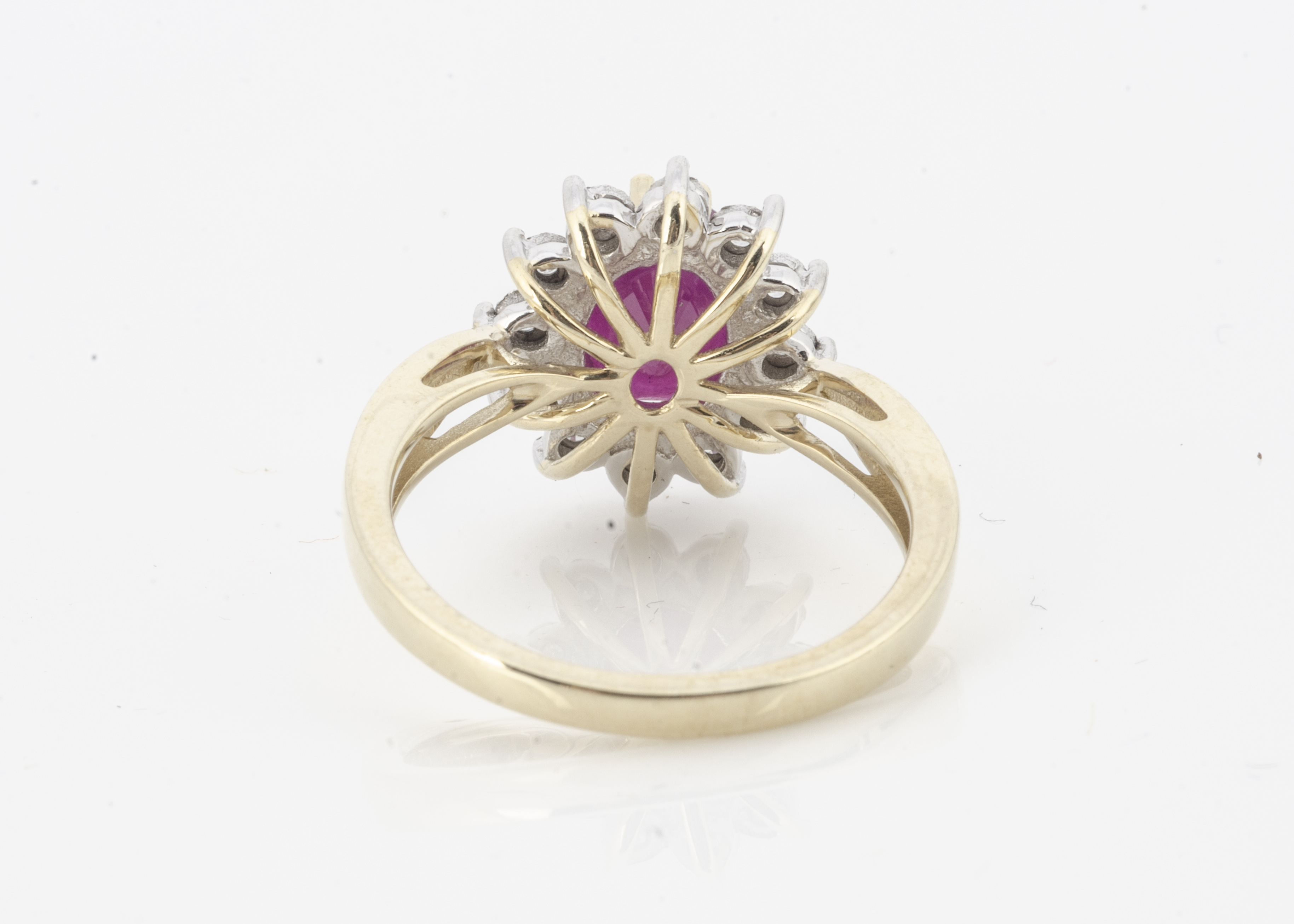 A 9ct gold ruby and diamond cluster ring, the opaque ruby surrounded by illusion set brilliant cut - Image 2 of 2