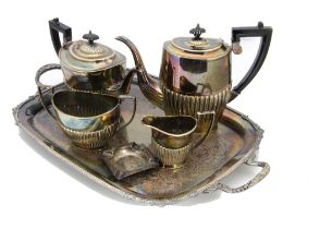 A collection of silver plate, including a twin handled tray, four piece tea set, sugar scuttle,