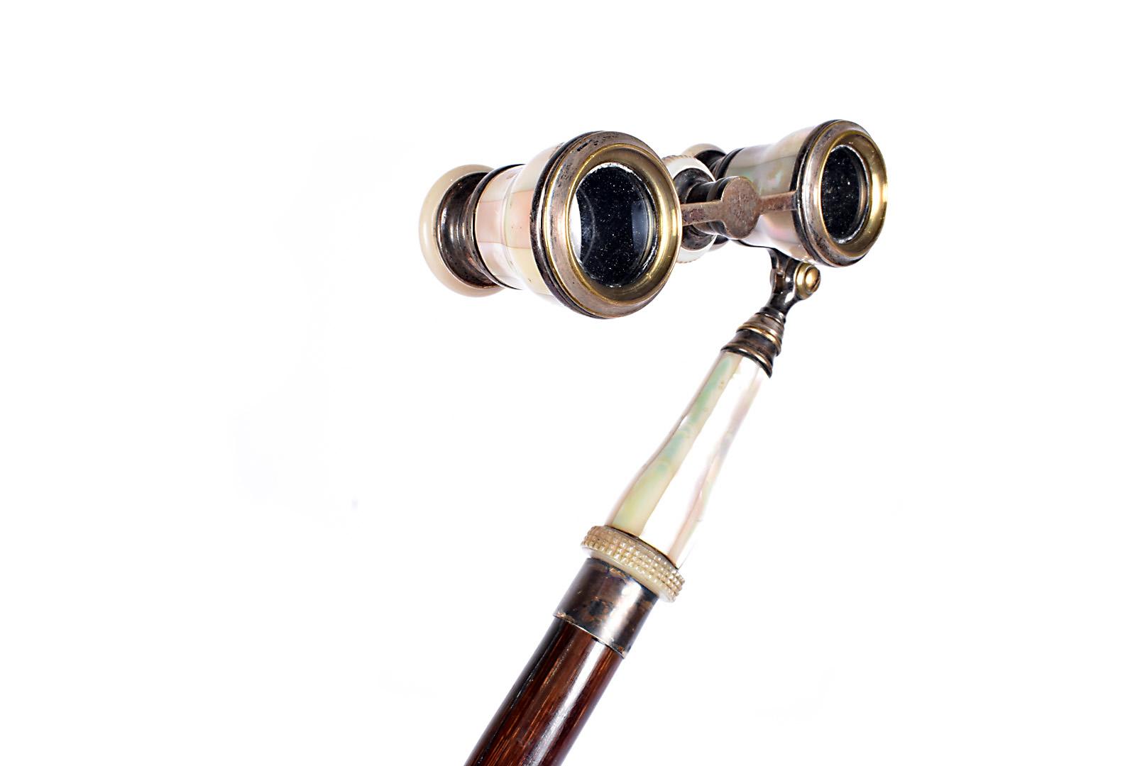 An Opera glass walking stick, the Stewart Dawson & Co Ltd mother of pearl pair of opera glasses