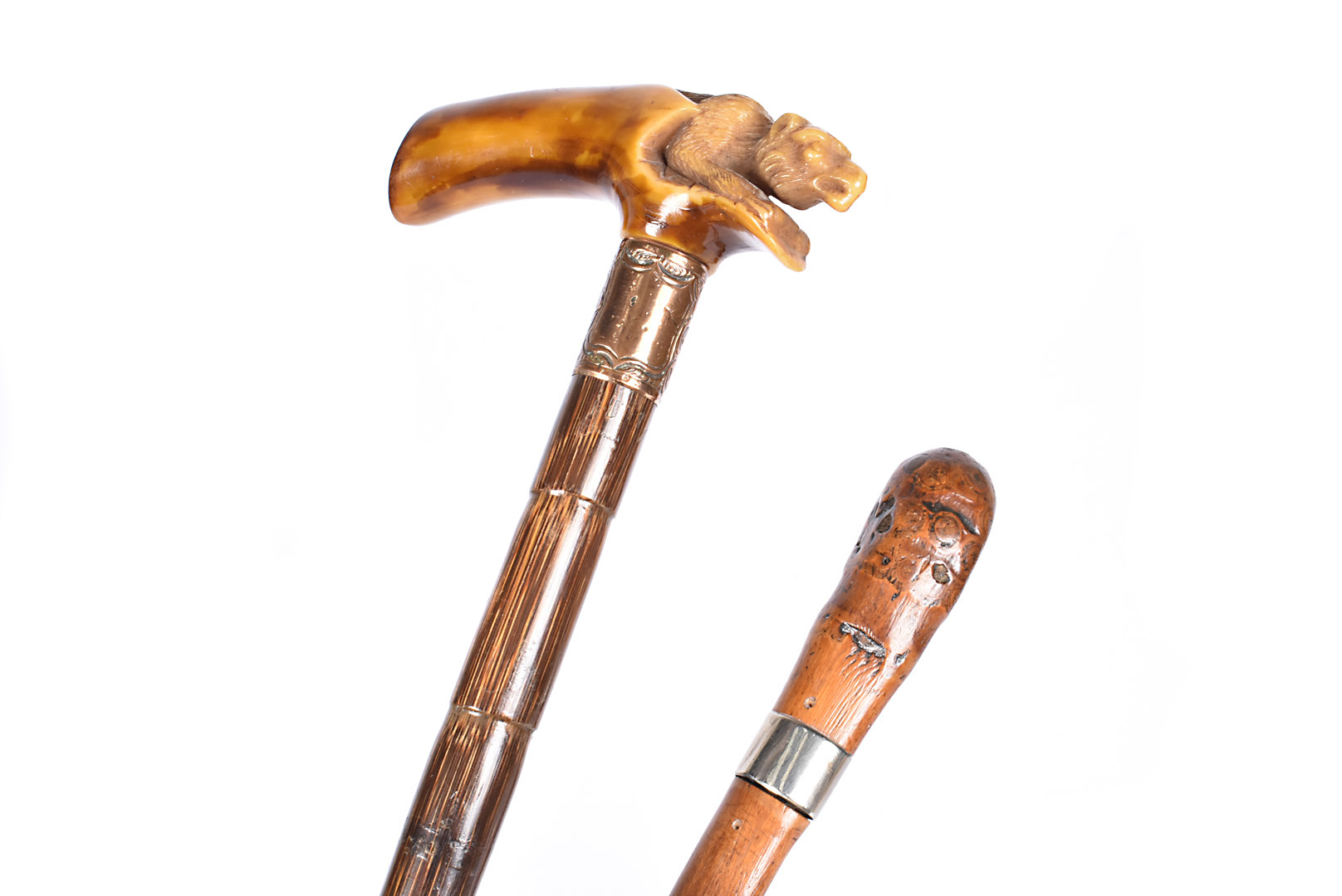 Two Edwardian sword sticks, one having a carved top, with lower gold plated collar, bamboo style