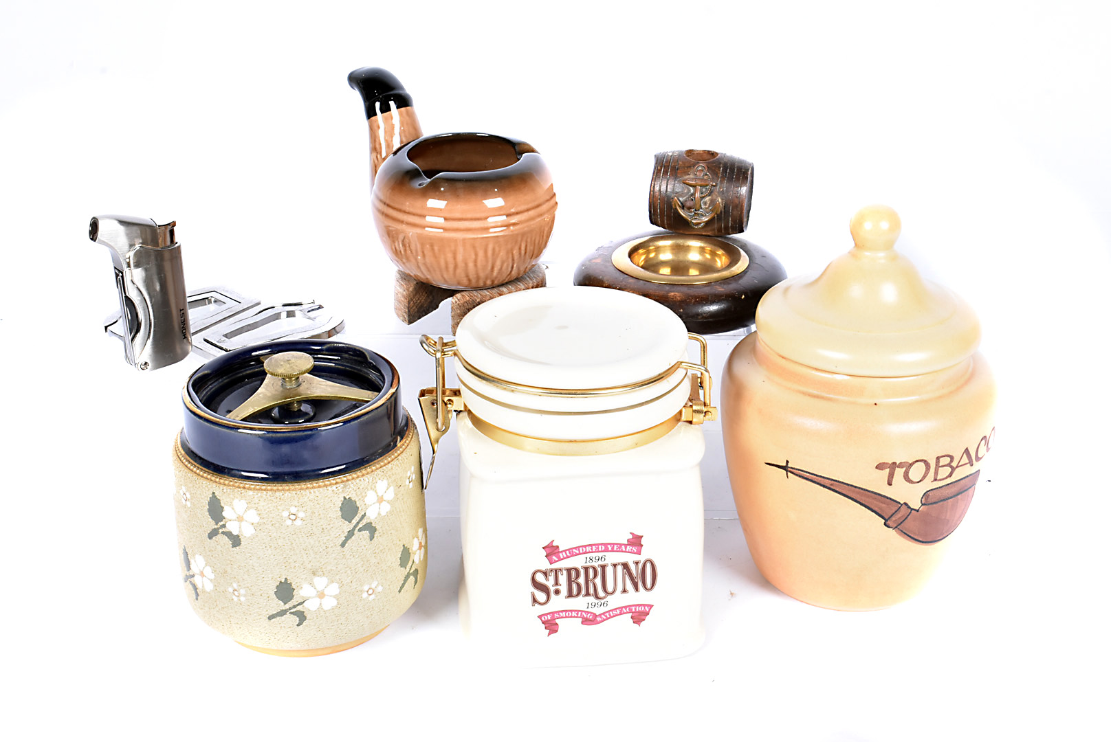 A small collection of ceramic tobacco jars, to include a Doulton style example, plus a selection