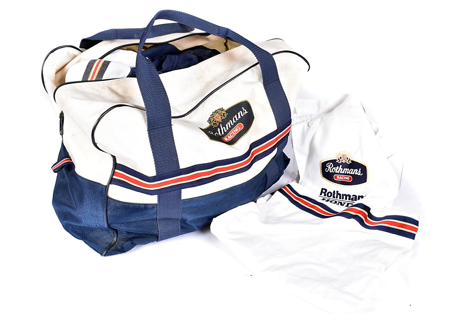 An assortment of Rothman Racing bags and clothing, comprising three various sized holdalls, a