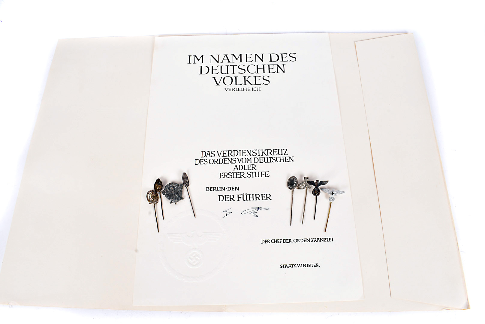 A reproduction Citation, having Third Reich blind stamp and signature, together with a small