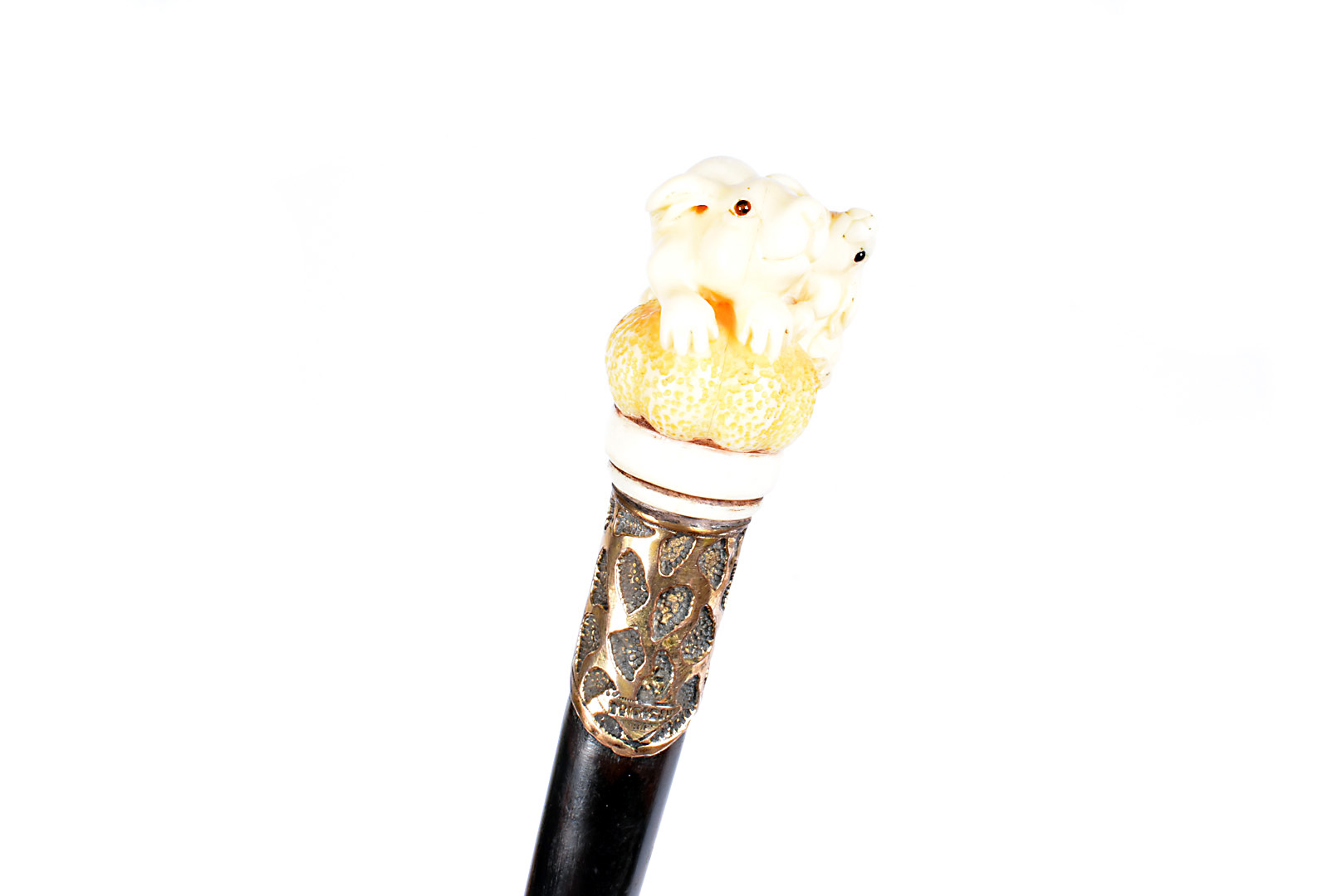 A carved ivory topped walking cane, the carved top in the form of a mother rabbit and kitten, having