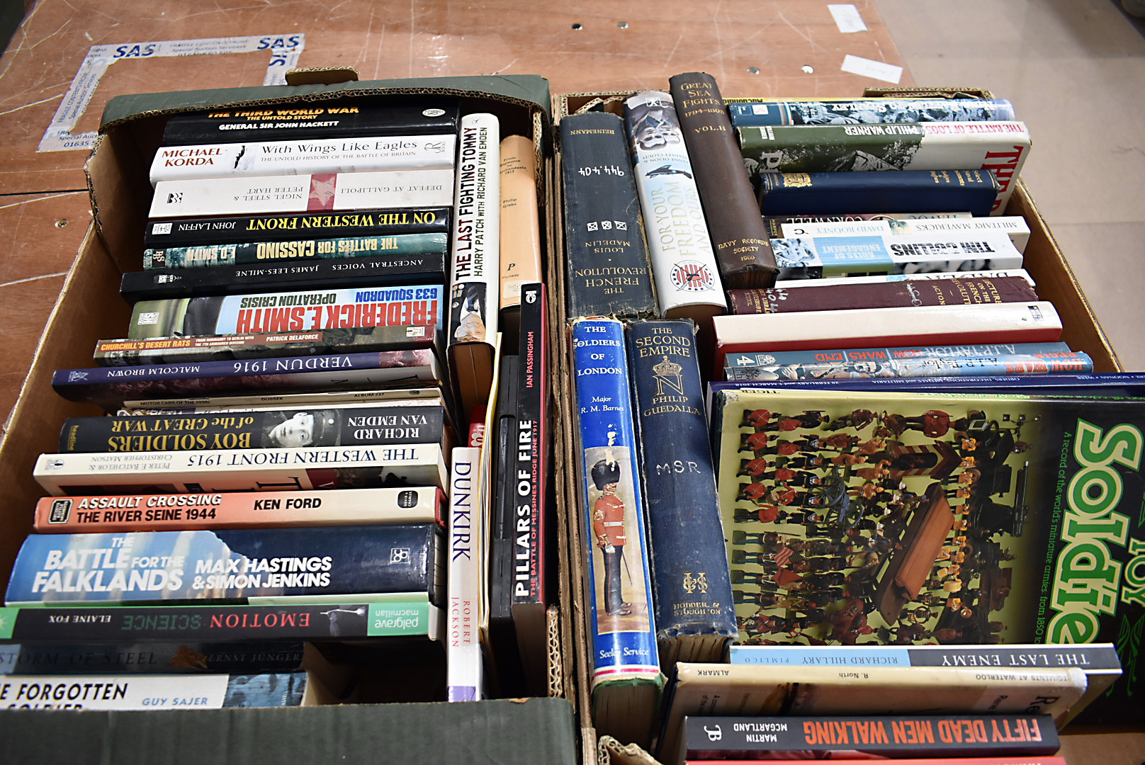 An assortment of military related fiction and non-fiction books, covering a variety of eras and