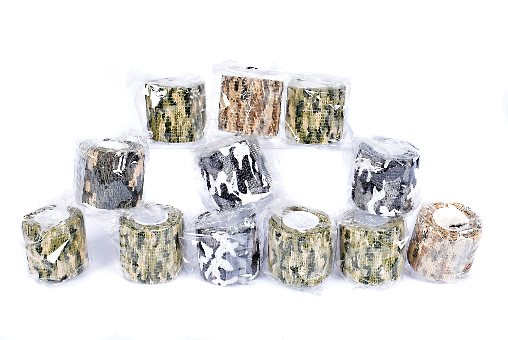 A group of twelve reusable rolls of camo tape, all sealed in original packaging, in various camo