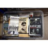 A large collection of various military related books, including The Falklands War 1982 by Martin