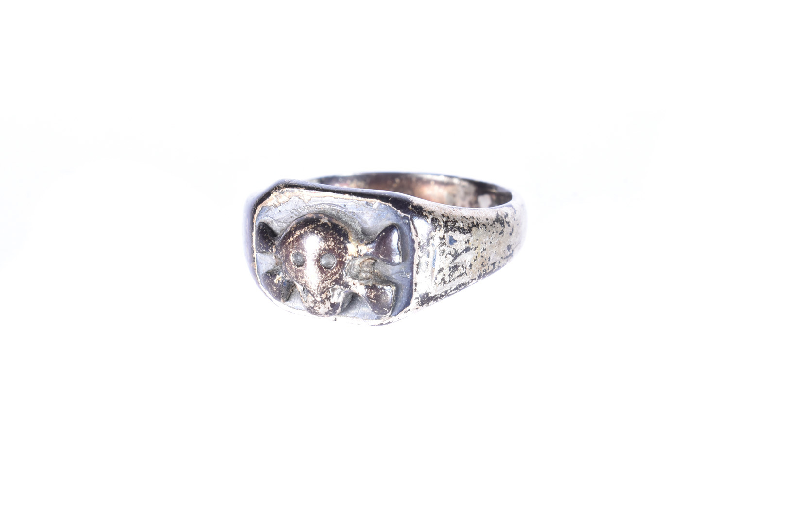 A German Third Reich Honour ring, possibly SS, the white-metal ring with skull and cross bones to