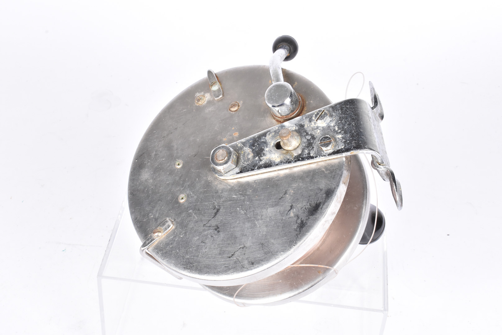 A large Allcock Sea Fishing reel, in chrome and white metal, 6 inch diameter - Image 2 of 2
