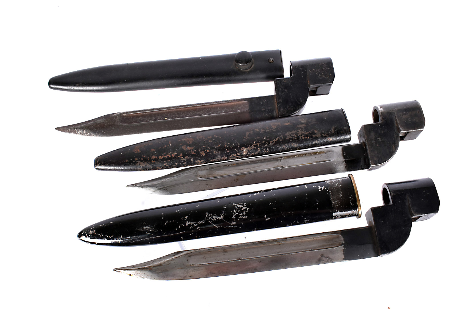Three No.9 MkI bayonets and scabbards, two stamped with broad arrows, one marked D-51 another D-