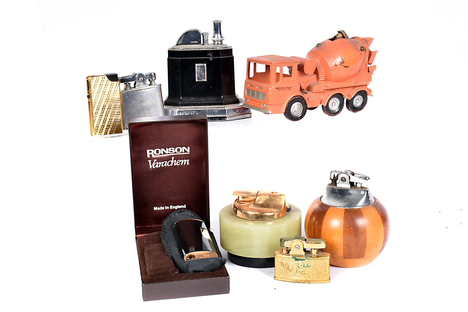 A small collection of Ronson lighters, including a Standard and table touch-tip, together with a
