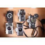 A Tray of Minolta Cameras, a Minolta SR-1, shutter working,body G, with 55mm f/1.8 Auto Rokker lens,
