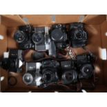 A Tray of Zenit SLR Cameras, a Zenit 212k, with Helios 58mm f/2 lens, a 122k, with Helios 58mm f/2
