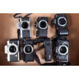 A Tray of Nikon Camera Bodies, a Nikkormat FT, shutter very sluggish on slow speeds, body G, a Nikon