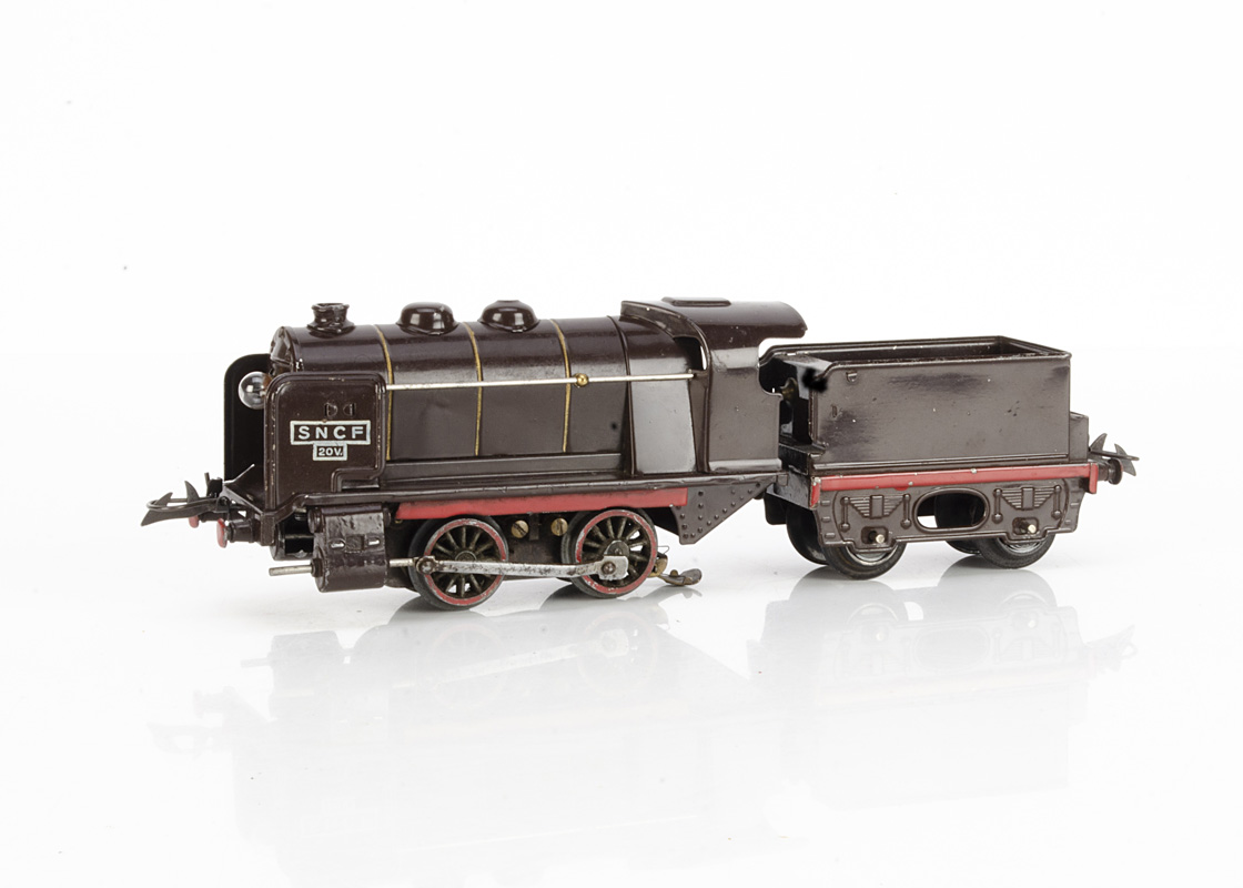 A French Hornby 0 Gauge No OE electric Locomotive and Tender, in brown with white rubber-stamped '