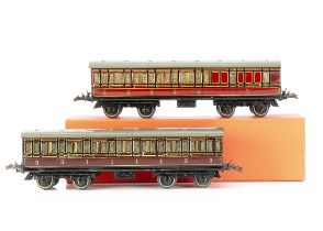 Two Hornby 0 Gauge No 2 Passenger Coaches, as brake/3rd no 22705 in lithographed LMS crimson, and