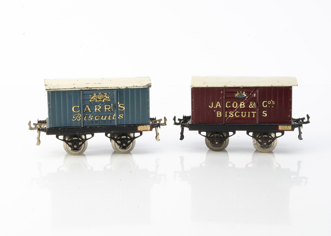 Hornby 0 Gauge 'OAG' Biscuit Vans, both with hinged doors and nickelled wheels, one Carr's