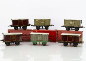 Hornby 0 Gauge No O tin-printed LMS Vans, three crimson Fish vans 7674, varying P-G, with two LMS