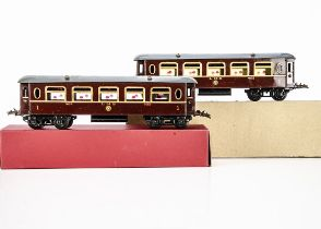 Two Hornby 0 Gauge No 2 LMS 1st class Saloon Coaches, both in enamelled LMS crimson as no 402, one